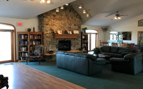 Gateway clubhouse interior by fireplace